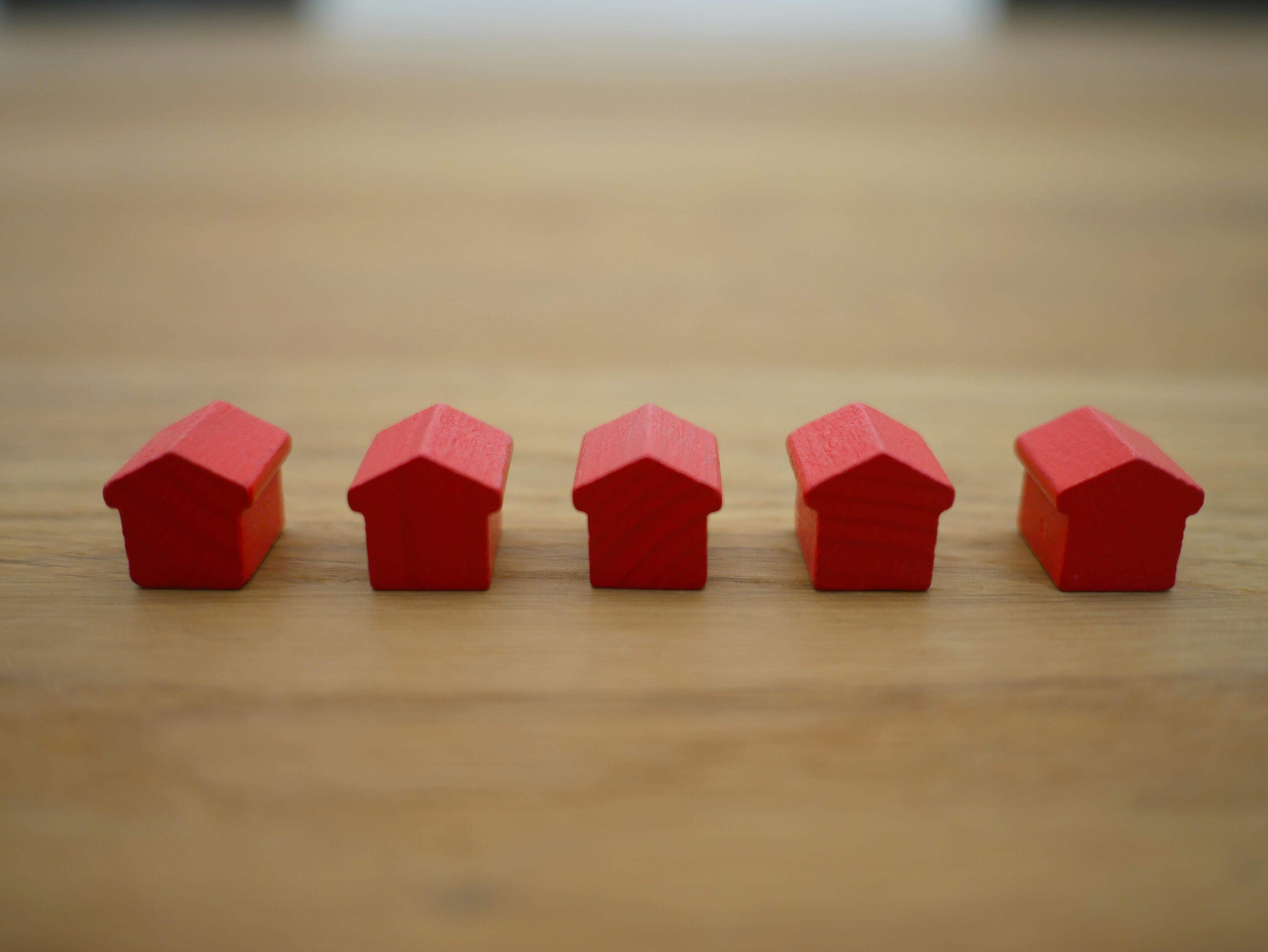 line of 5 red house toys