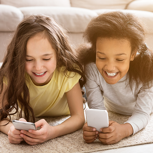 Children playing on mobile phones for How it Works section.