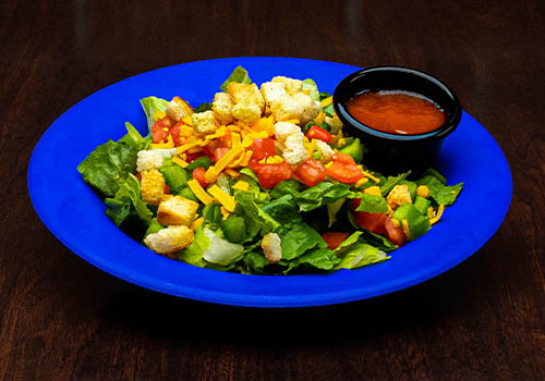 side salad including crutons, chopped tomatoes, cheddar cheese, and more