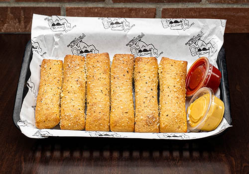 parmersean crusted breadsticks with marinara and garlic butter dipping sauce