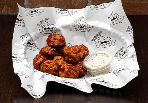 small basket of boneless wings with chipotle honey barbecue sauce
