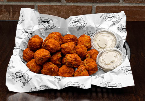 large basket of boneless wings with buffalo sauce