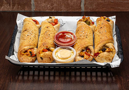 four flinger rolls filled with mozzerella cheese and various other toppings