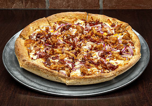craft pizza with barbecue sauce, onions, and smoked chicken
