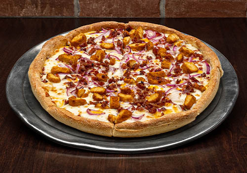 craft pizza with a ranch base, chicken, onions, and more