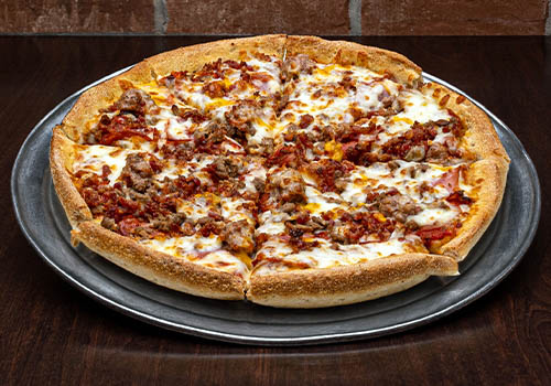 craft pizza packed with pepperoni, sausage, bacon, and more