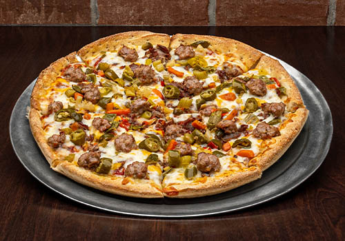 craft pizza with sausage, peppers, and more