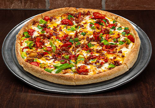 craft pizza with bacon, smoked chicken, tomato, pepper, and more