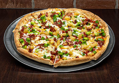 craft pizza topped with bacon, ham, pineapple, green peppers and more