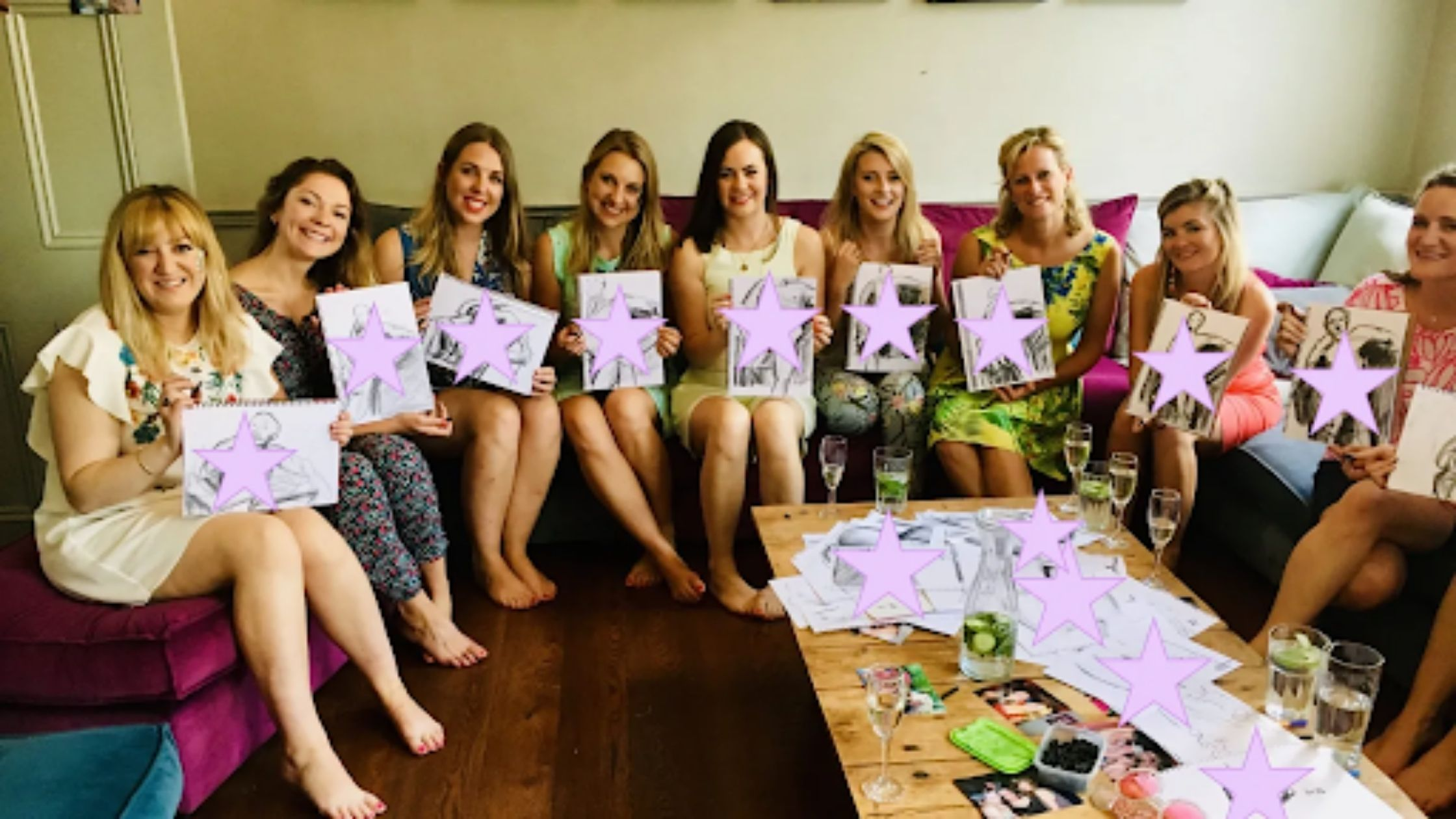 A hen party proudly showing off the art they've created