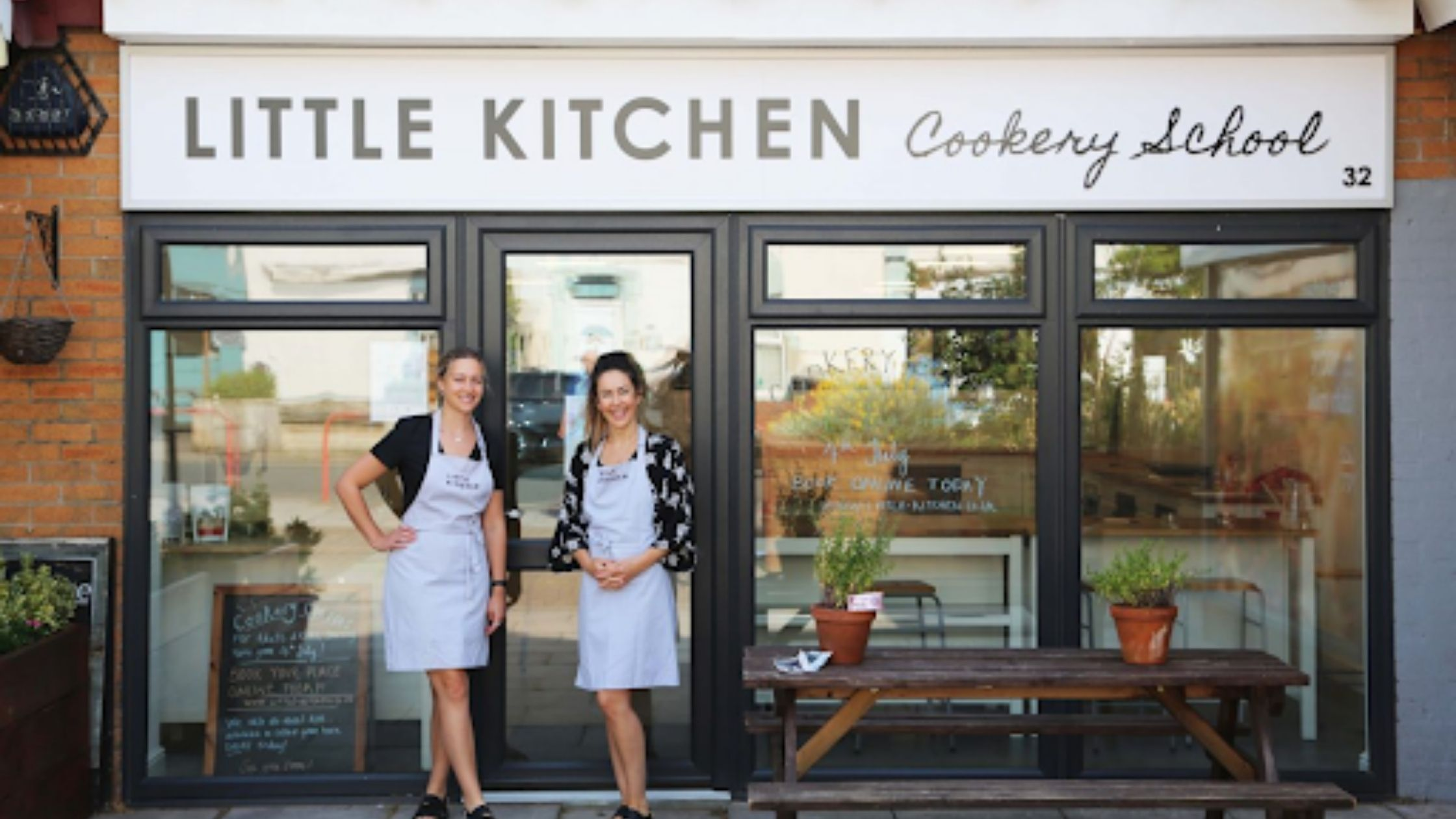 Claire and Madeleine in front of the Little Kitchen cookery school