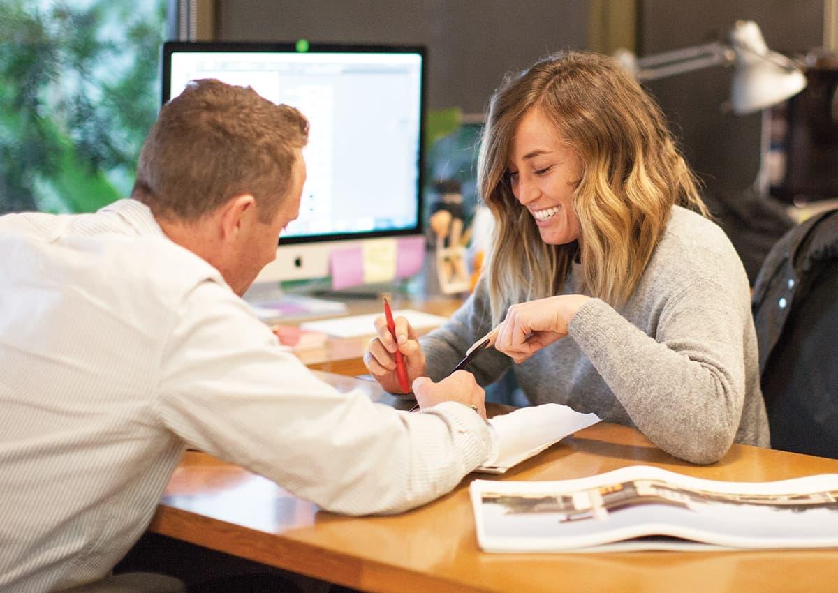 Senior Associate Jeffrey Hertzler and designer Emily Boelsems collaborate in the office.