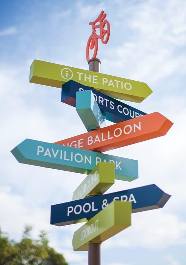 Great Park Neighborhoods colorful pedestrian wayfinding flag directional signage.