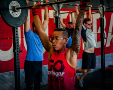 Doctor Shante Cofield performing a barbell press-up exercise