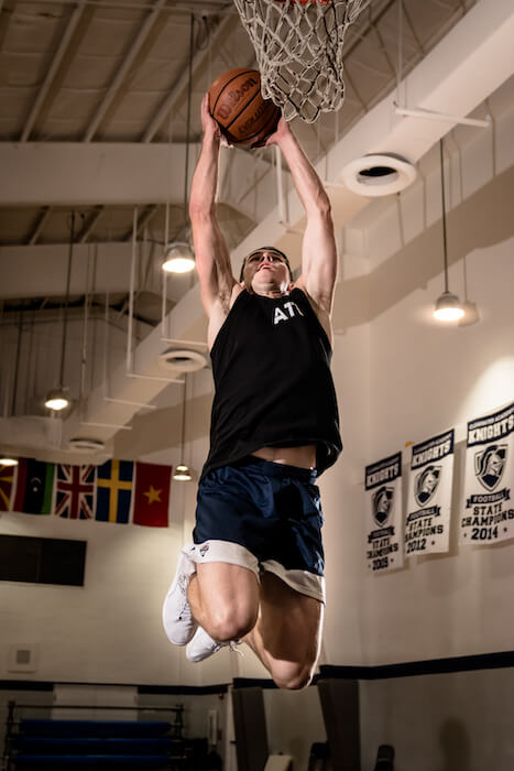 Ben Patrick in the air about to dunk