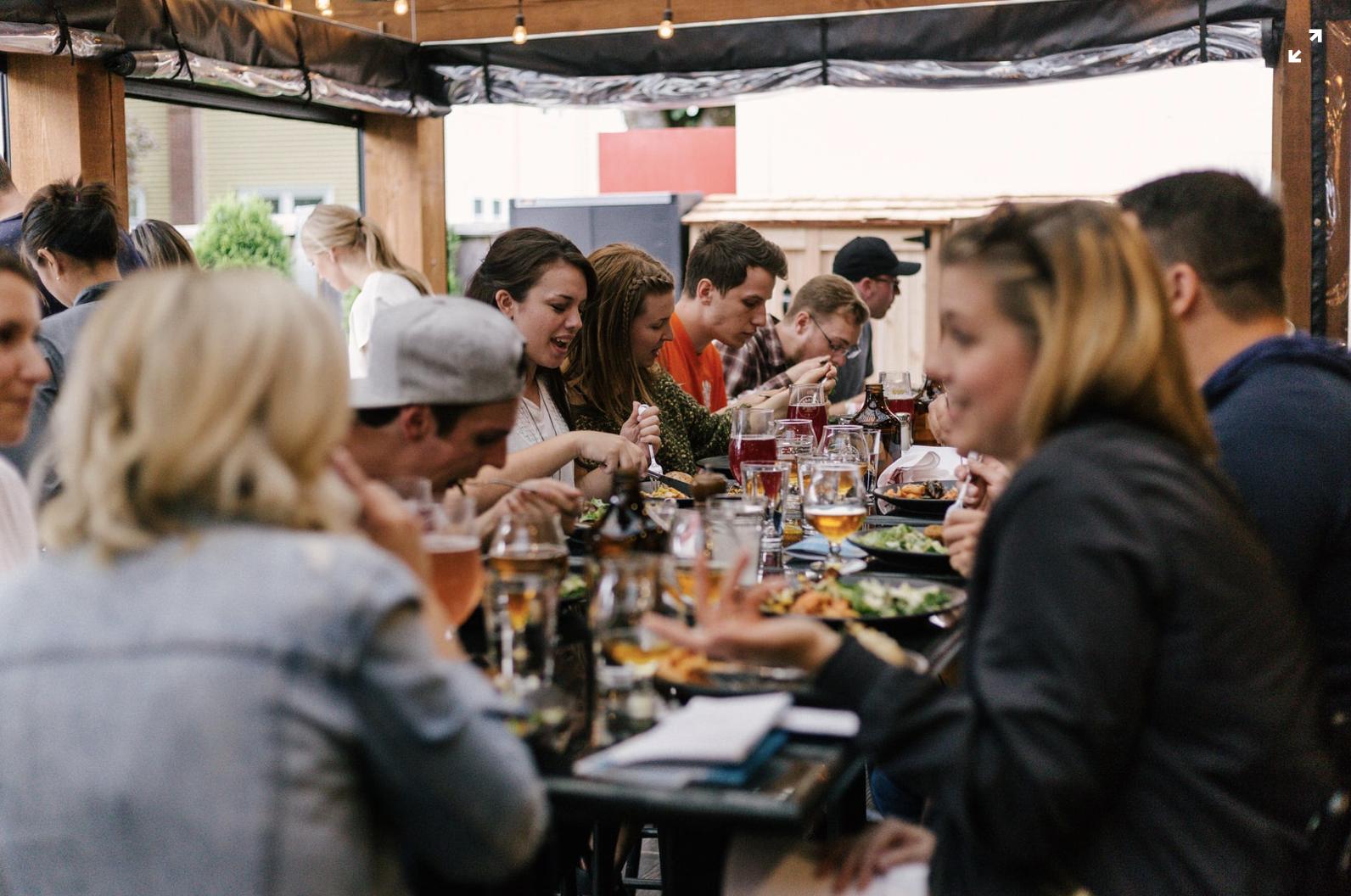 Social gathering for dinner after work. CC: Prisilla Du Preez on Unsplash.
