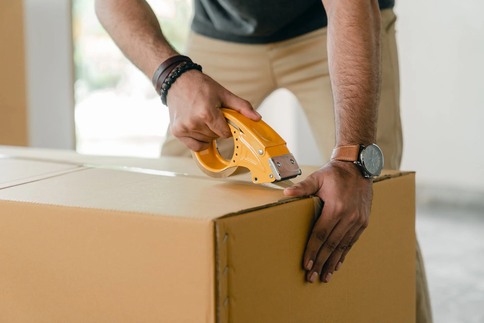 Man packing up a box for courier