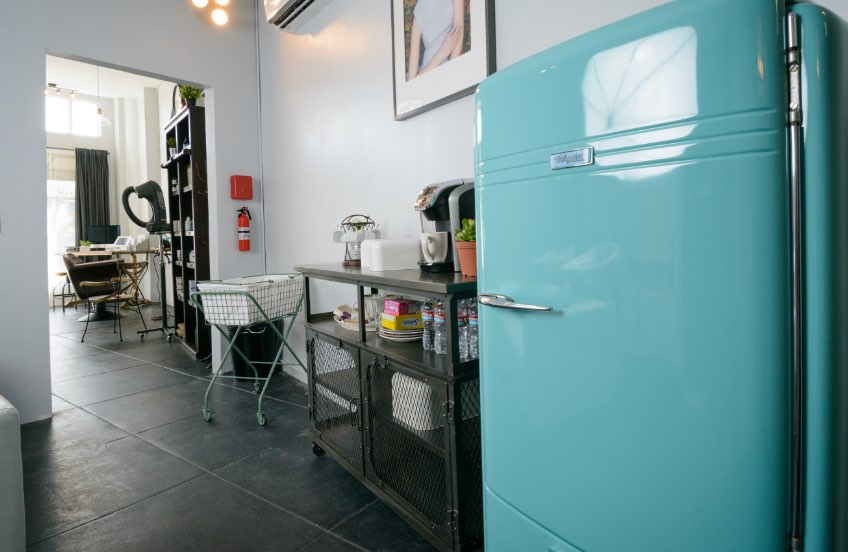 Turquoise refrigerator at The Hair Parlor On 8th