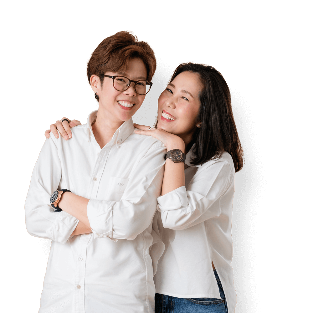 A smiling asian lesbian couple