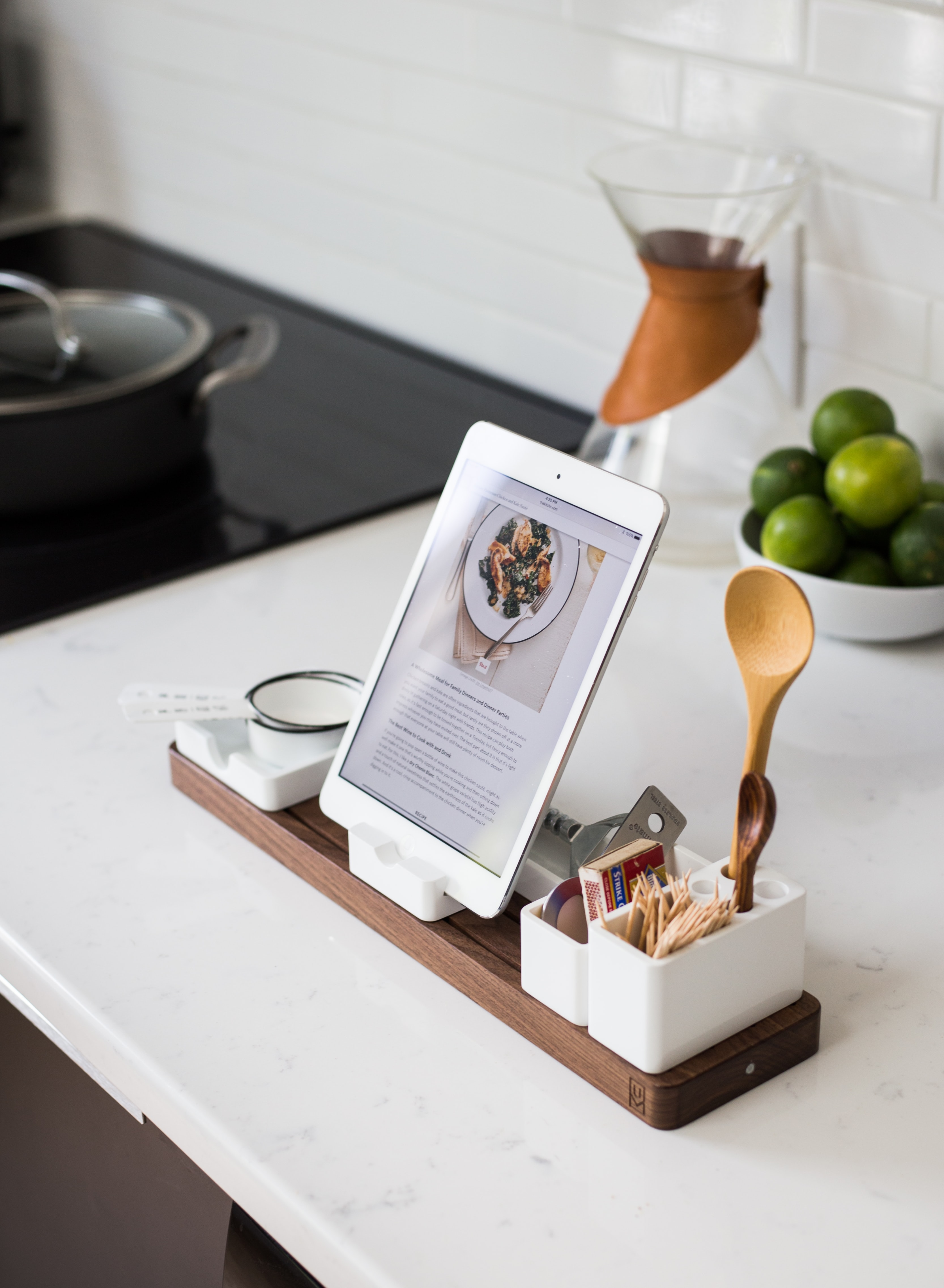 a phone on a counter with artisan bread recipes on the screen