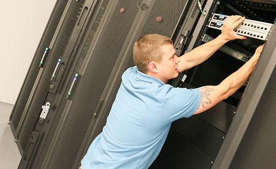 managed data center services technician installing server