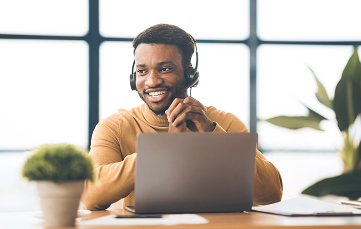 technical consultant with headset providing complimentary hear from a human support
