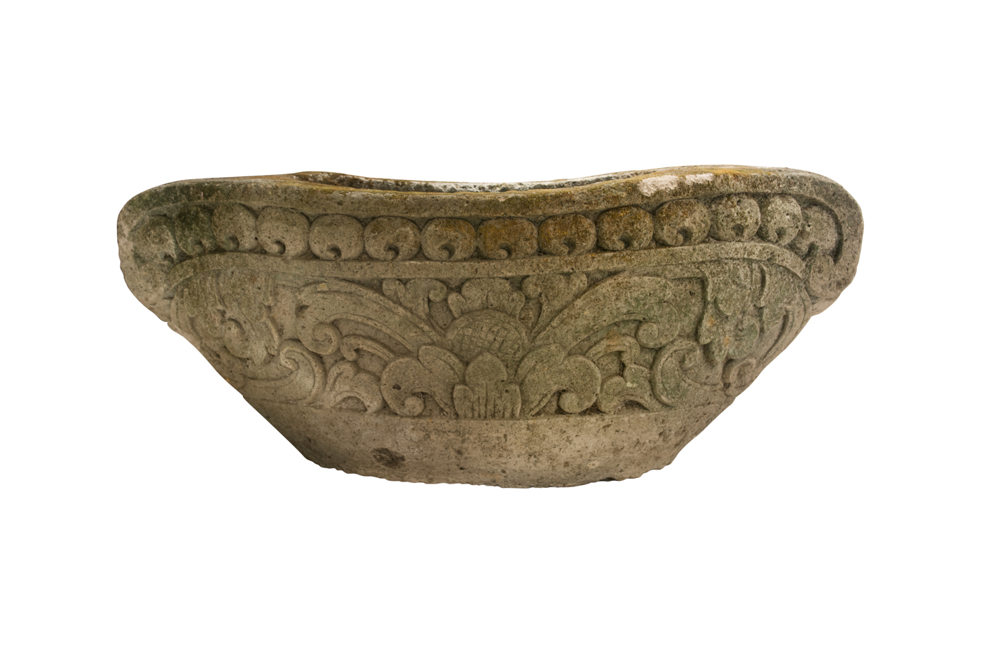 Pot carved in stone in the shape of a boat