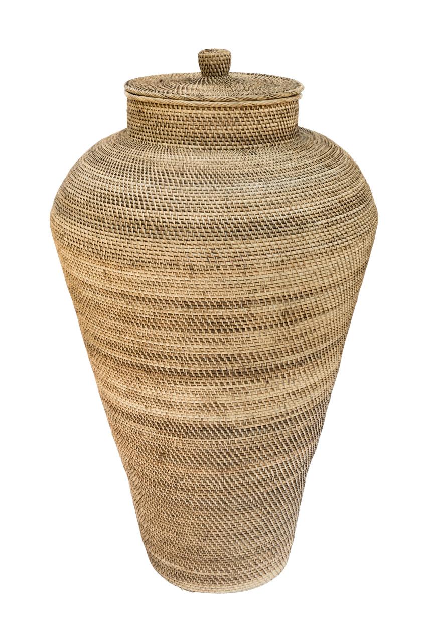 Conical floor vase in rattan
