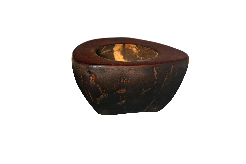 Cenicero de coco marrón.