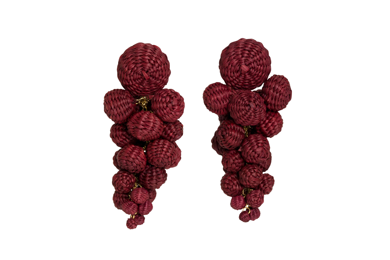 Iraca palm drop earrings red wine