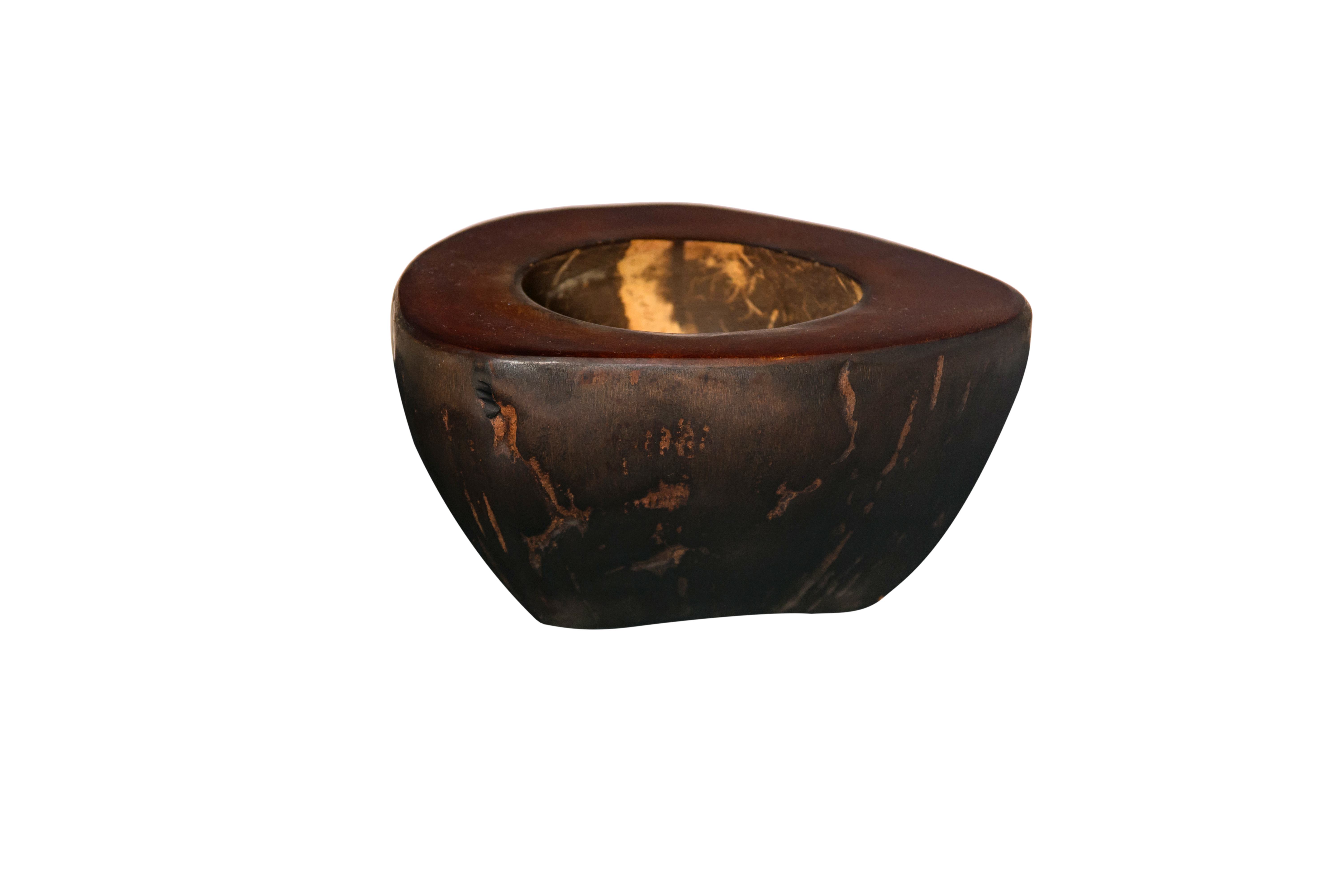 Brown coconut ashtray.