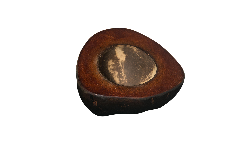 Brown coconut ashtray.