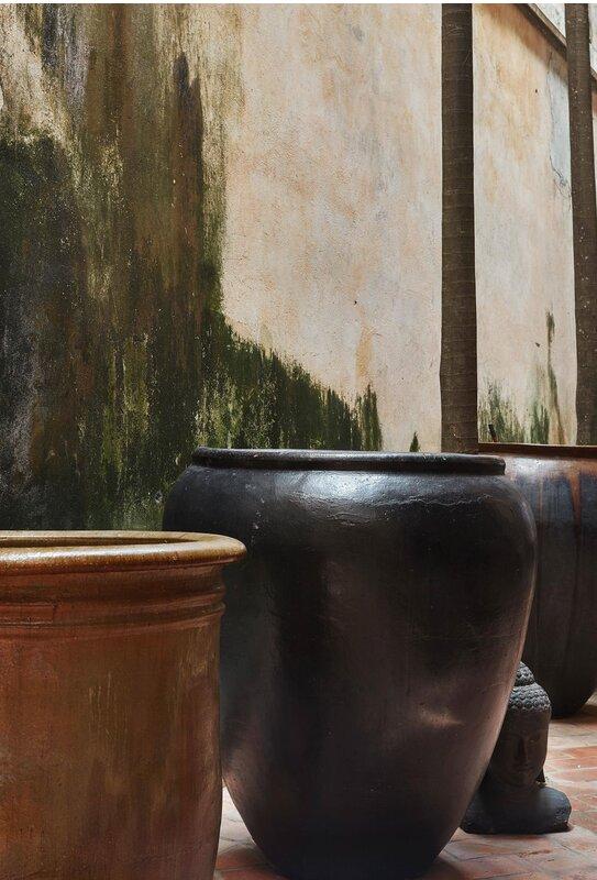 Carved earthenware jar