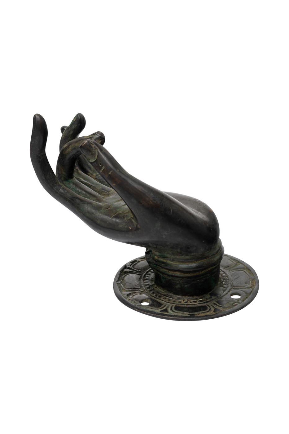 Mano decorativa en bronce