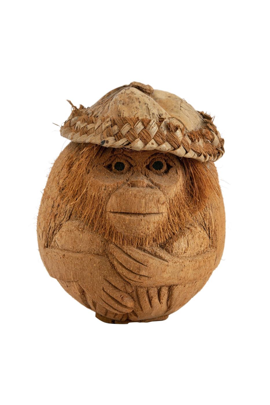 Coco decorativo con figura de mono