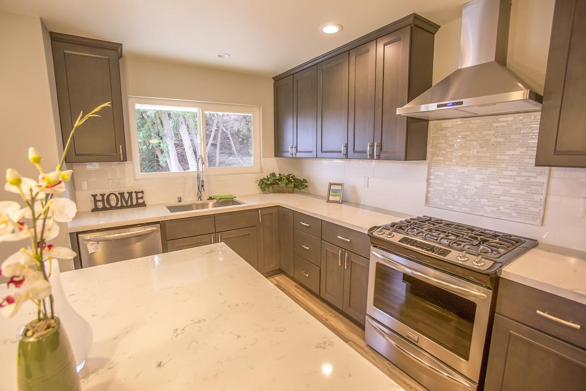 oak cabinetry and quartz countertop