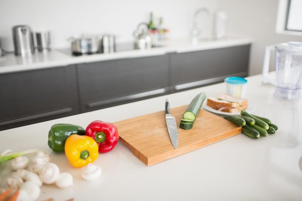 a chopping board on a quartz countertop
