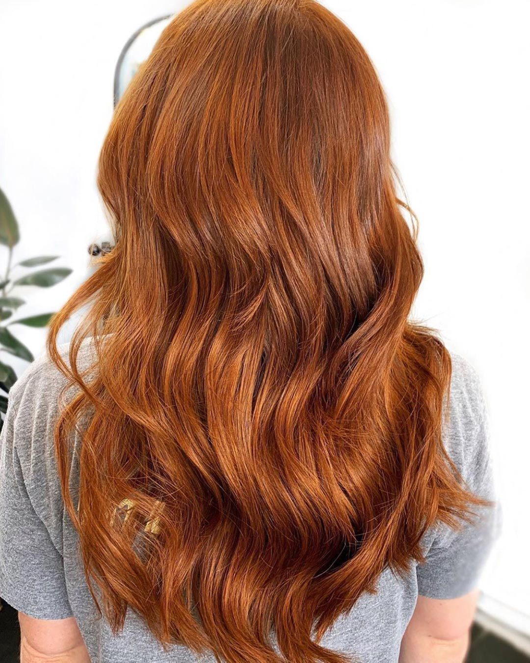 Natural copper hair color with weft extensions added for length and volume.