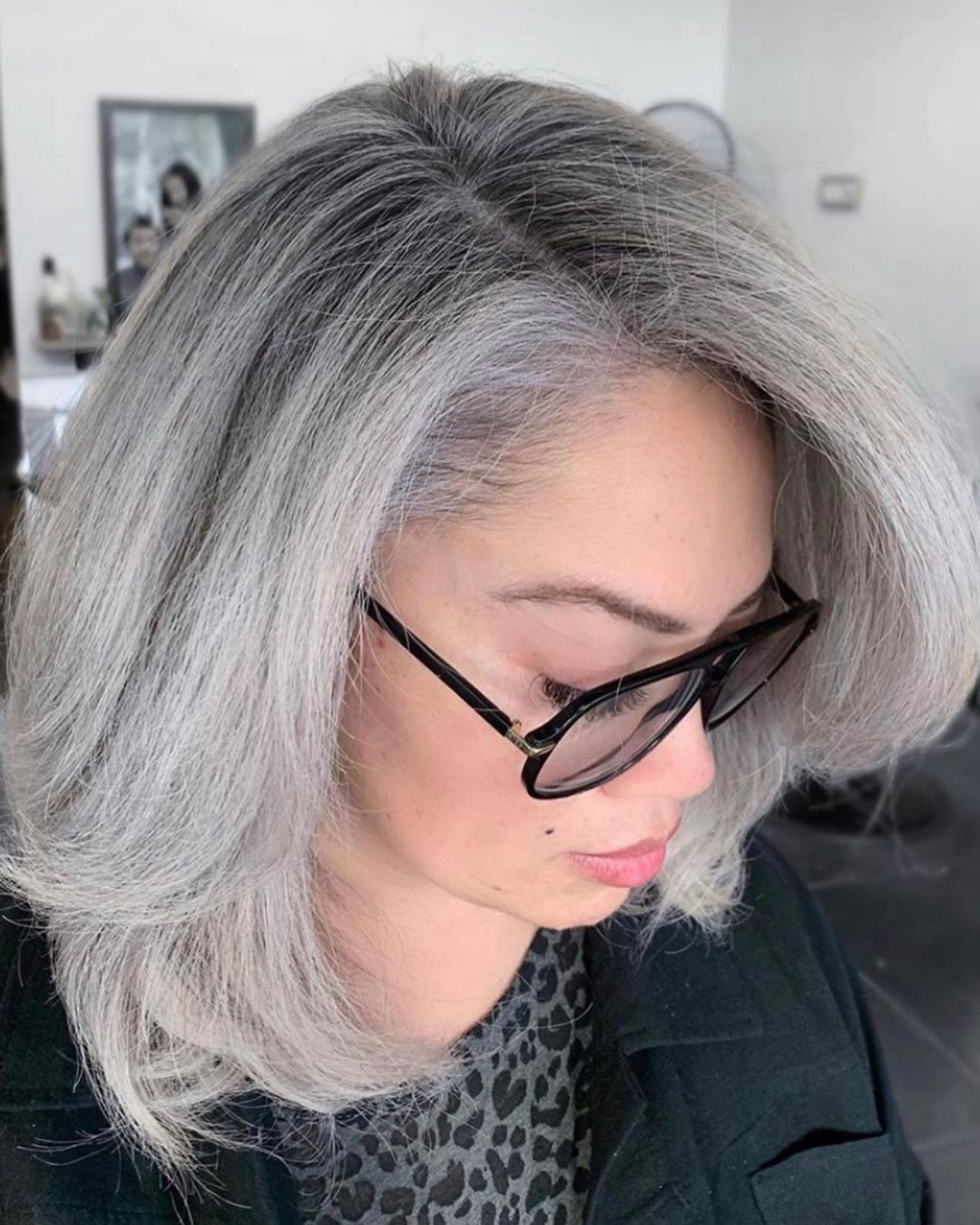 Fresh silver highlights on her naturally black hair blended the greys beautifully, by Andrew Smith
