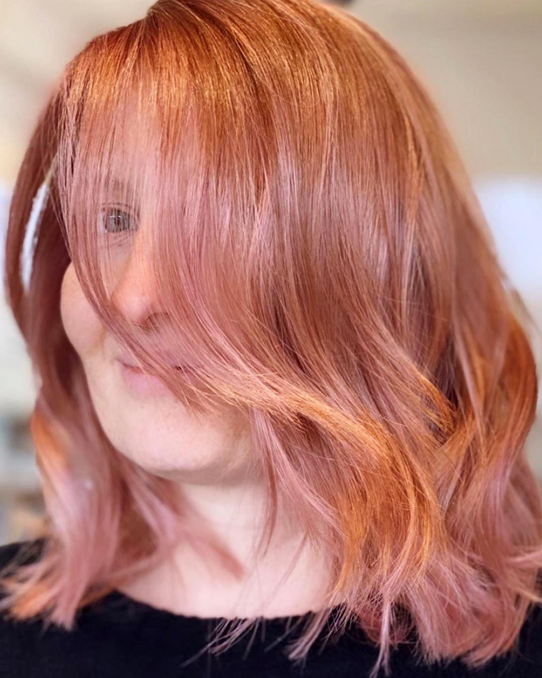 Rosy pink color hair cut and style created by Owner/Stylist, Sophie Davies