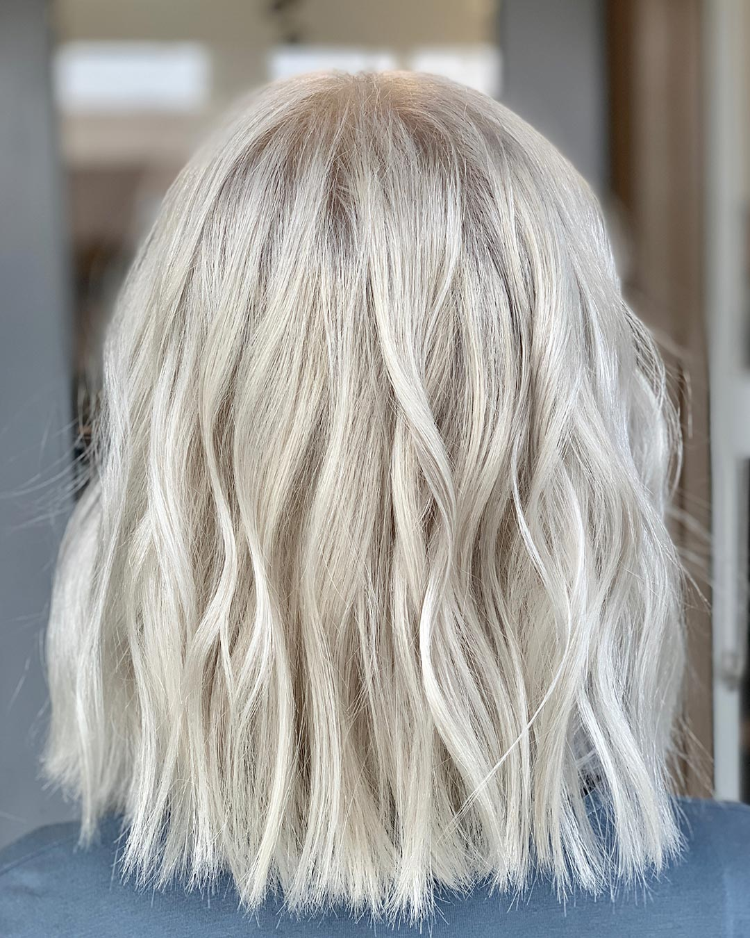 Months of careful color went into this beautiful platinum. Color and hair cut by Mariah Hottell.
