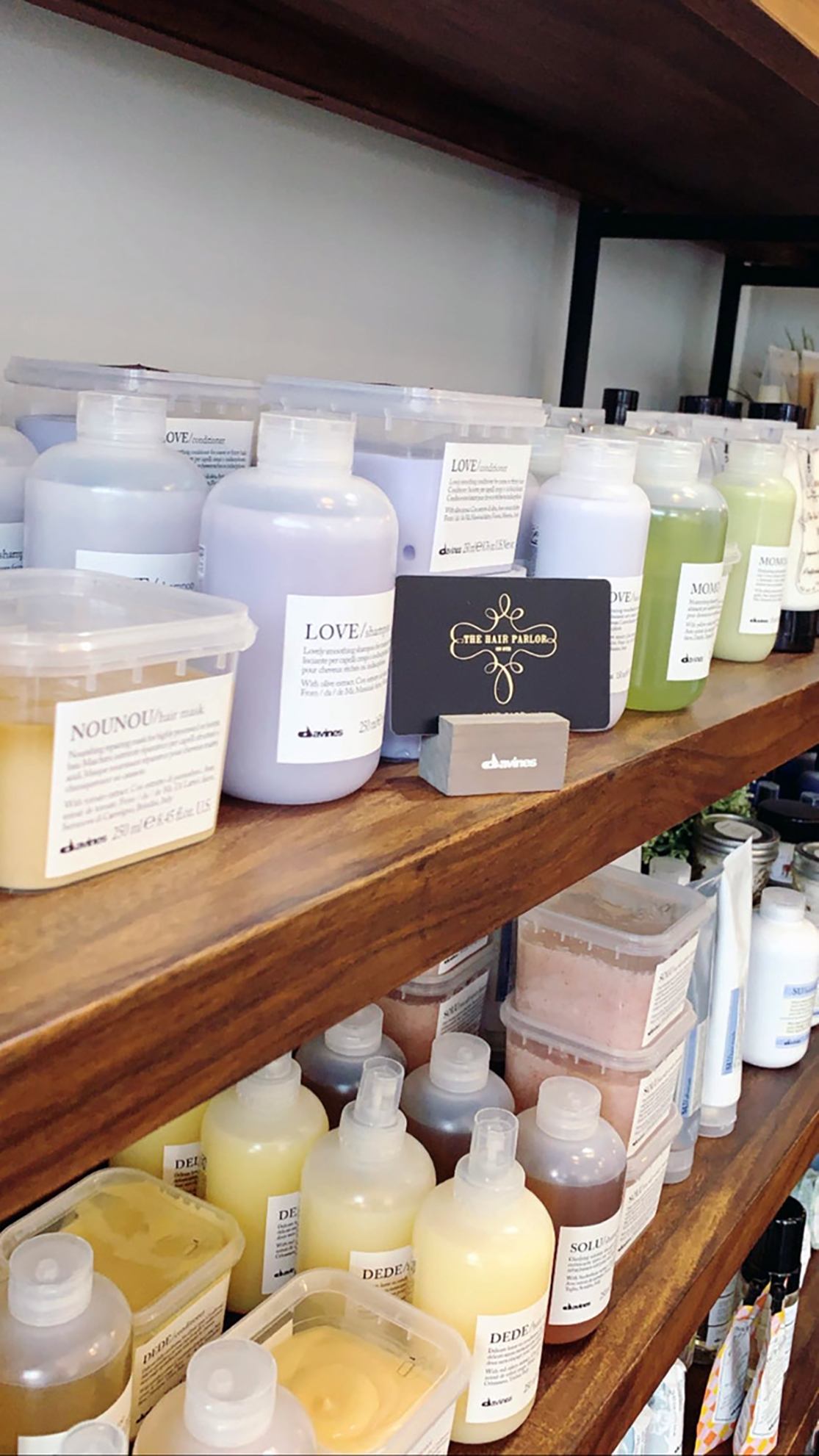 Davines Hair Care lines our shelves. Fully stocked and eco-friendly pacakaging. 100%.