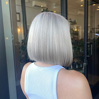From black to icy blonde in 2 sessions. Hair by Andrew Smith
