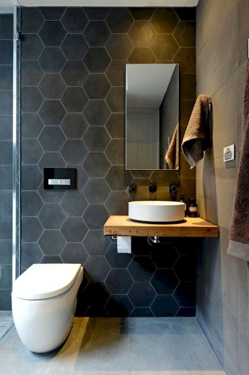 banheiro revestimento hexagonal preto