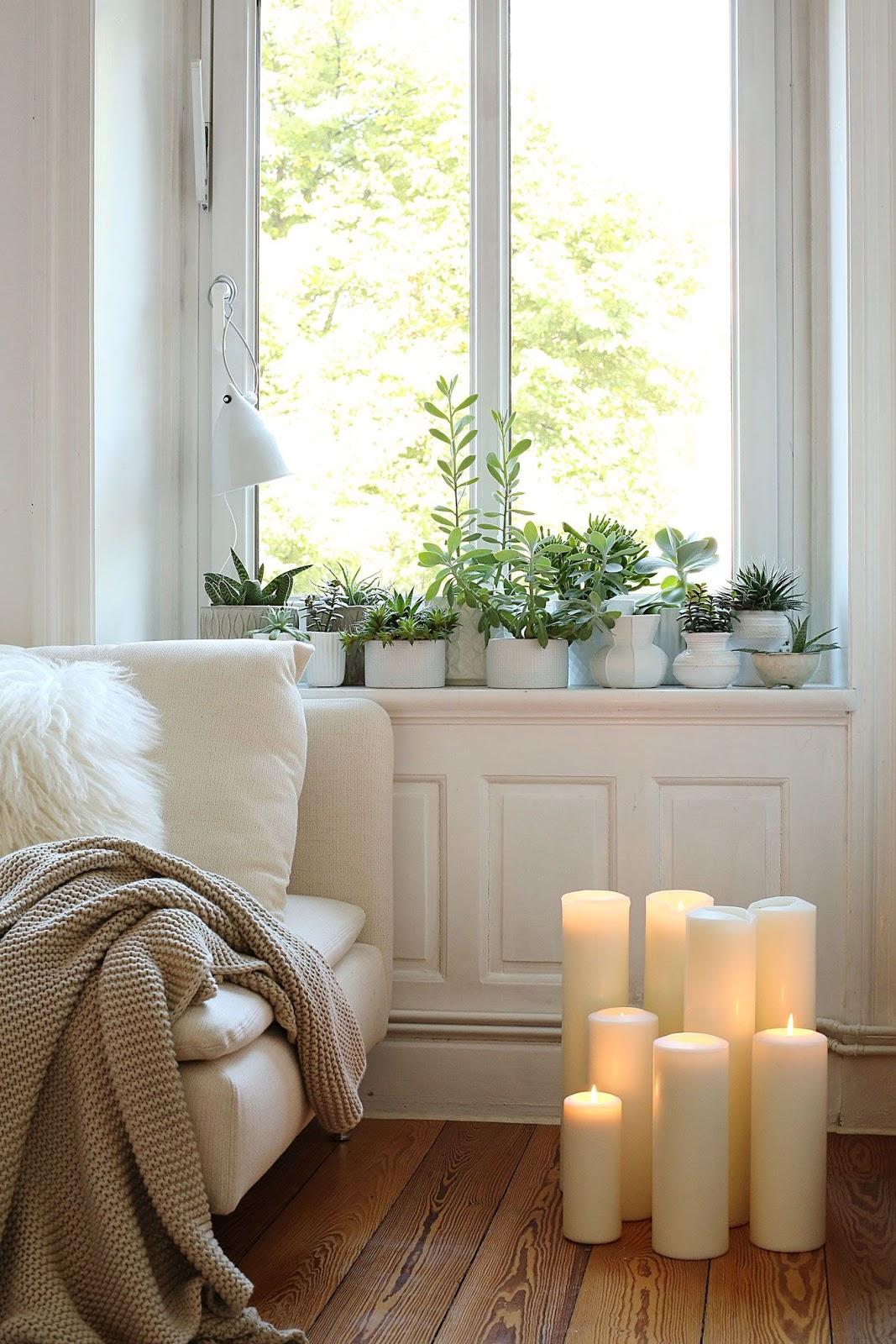 sala de estar decoração plantas e velas