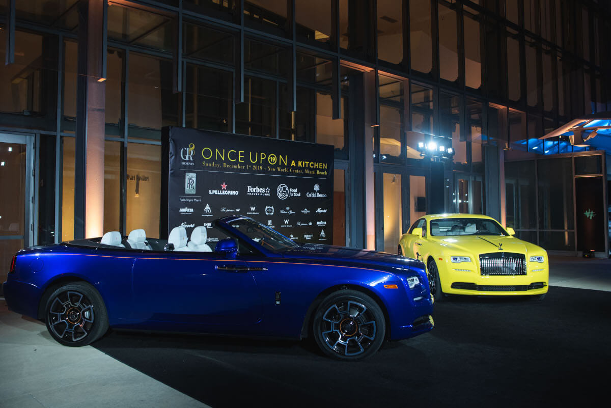 two luxury cars for a luxury culinary gala