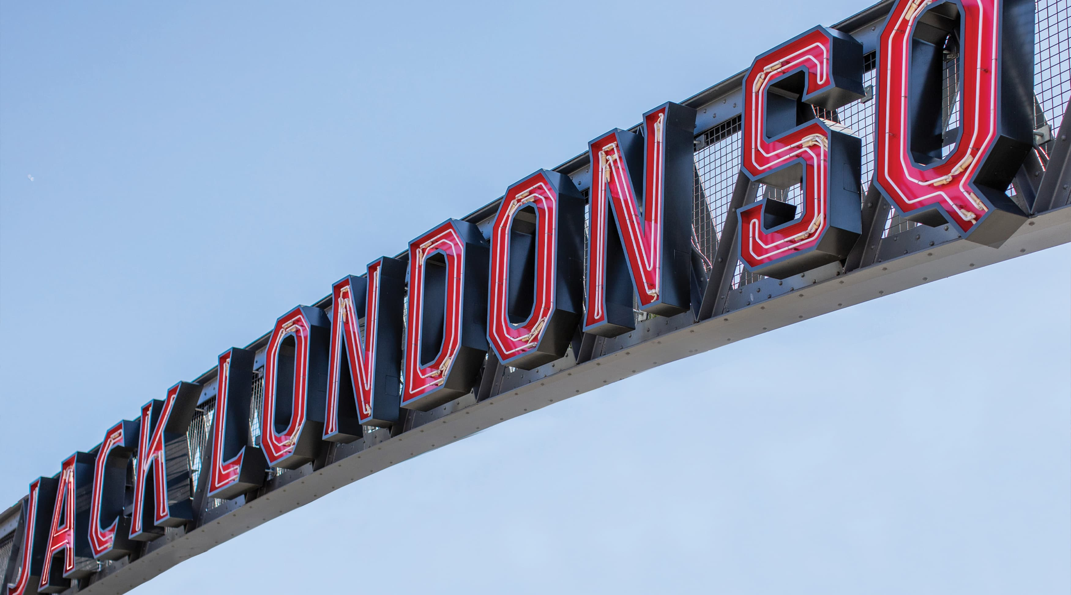 Jack London Square open face channel letters and exposed neon mounted on gateway element