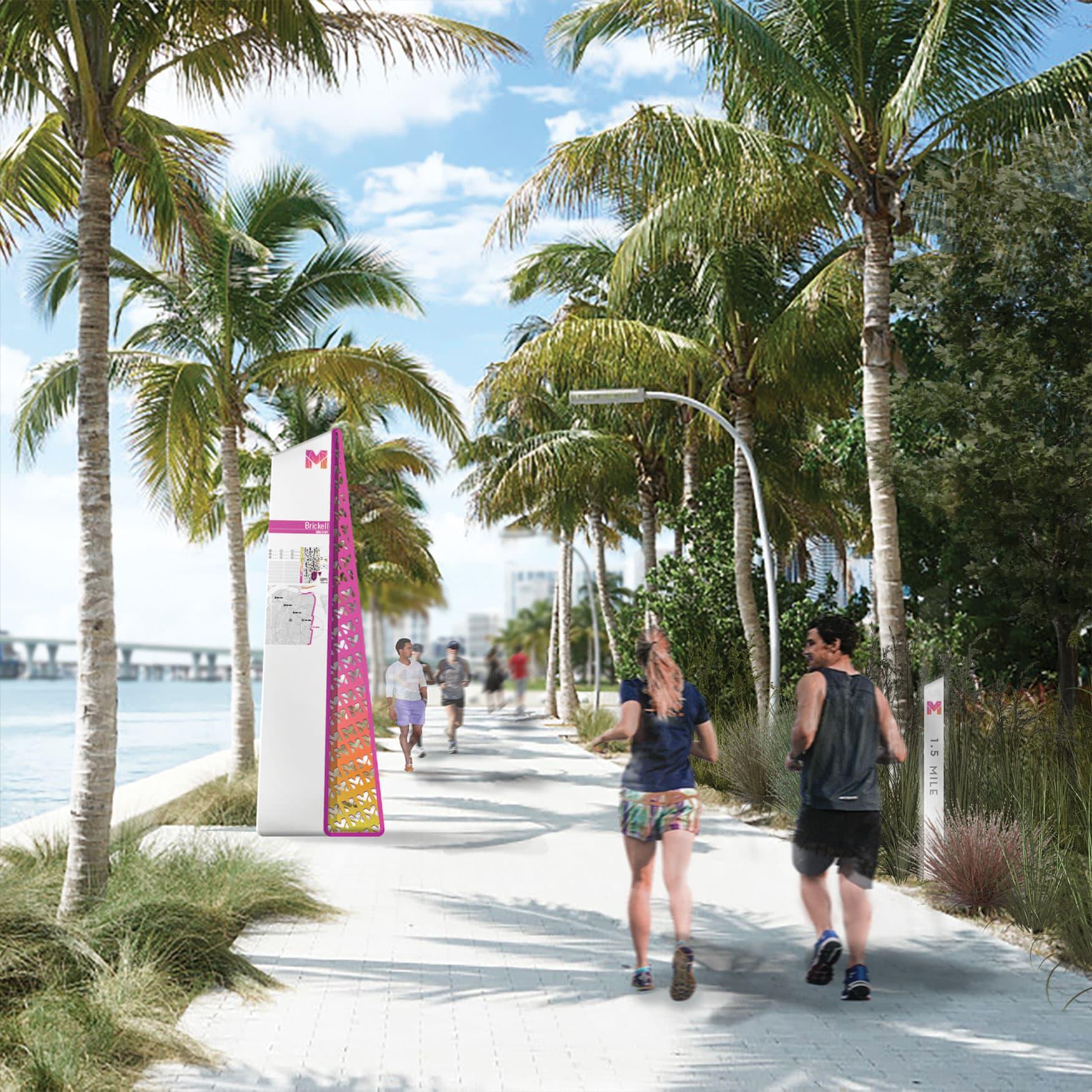 Wayfinding signage along the waterfront walkway of Miami Baywalk.