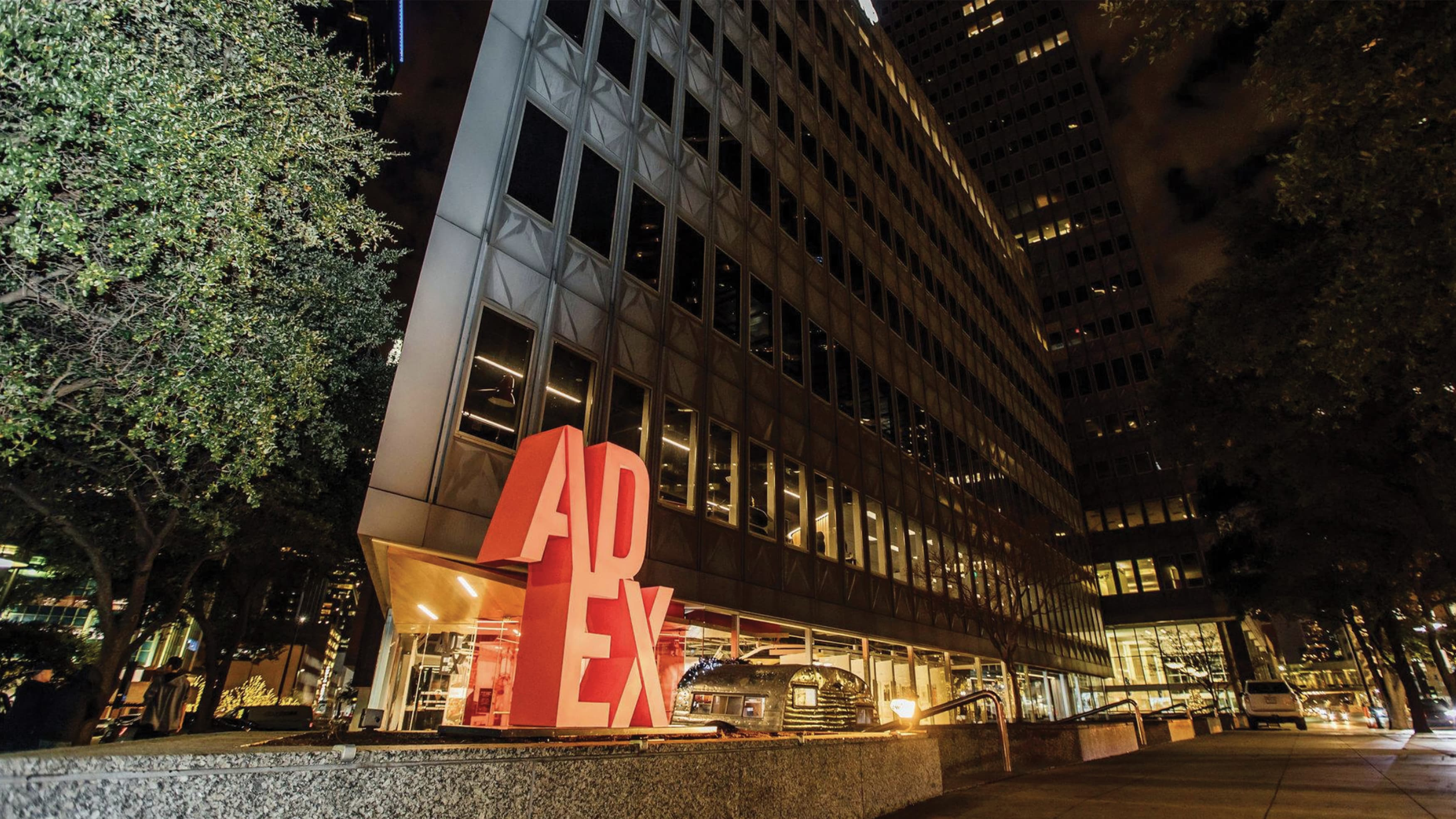 Exterior monument signage and streetscape outside Ad Ex building in downtown Dallas