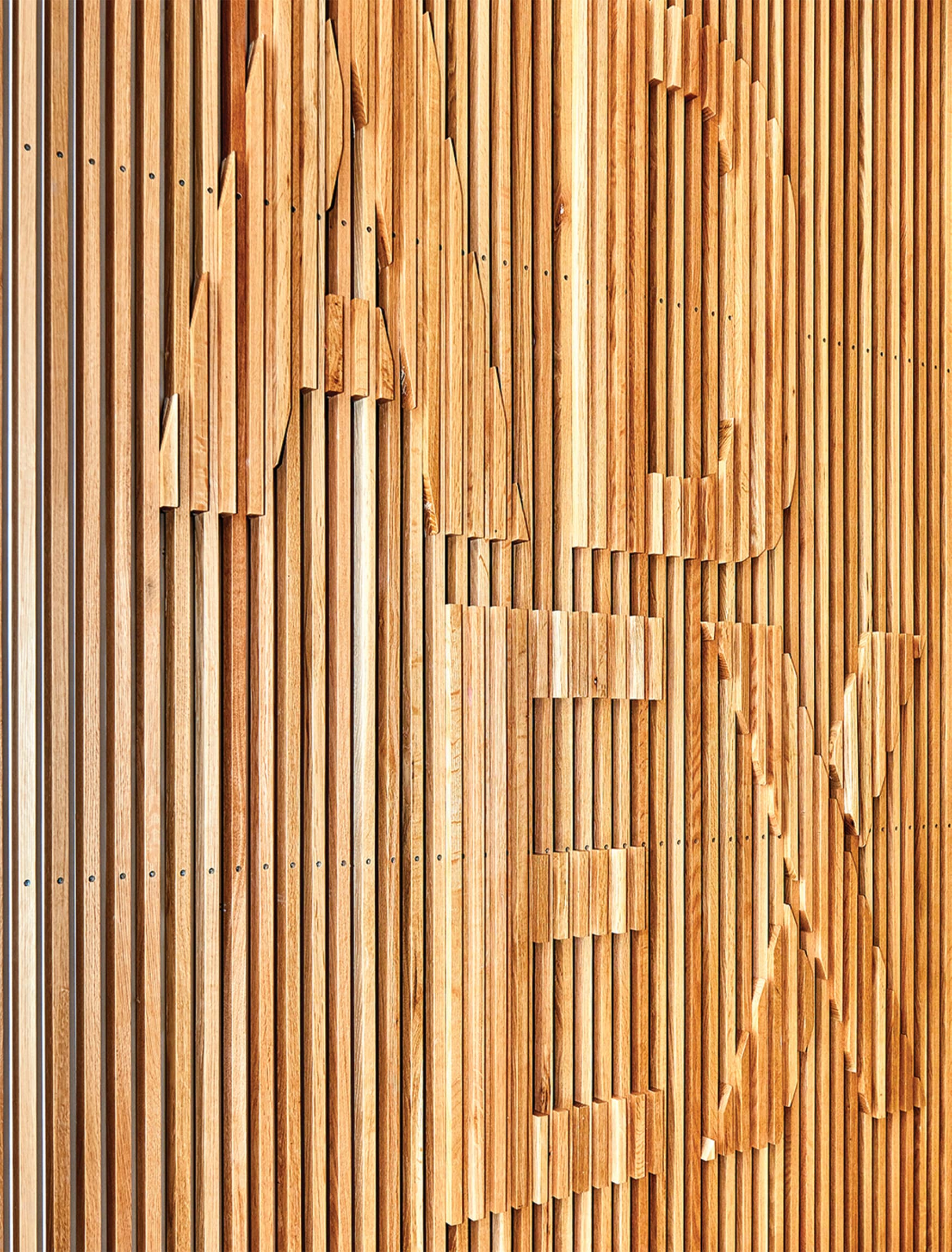 Architecture and Design Exchange wood-slat-relief signage